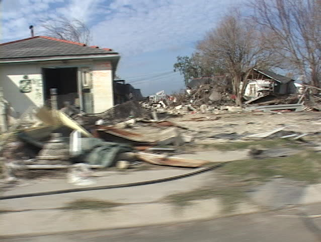 Rubble and debris has been piled on the side of the road shows the destruction caused by Hurricane Katrina.