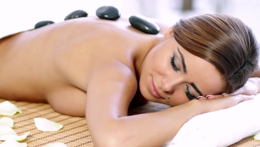 Attractive brunette woman getting hot stones spa treatment - HD stock video clip