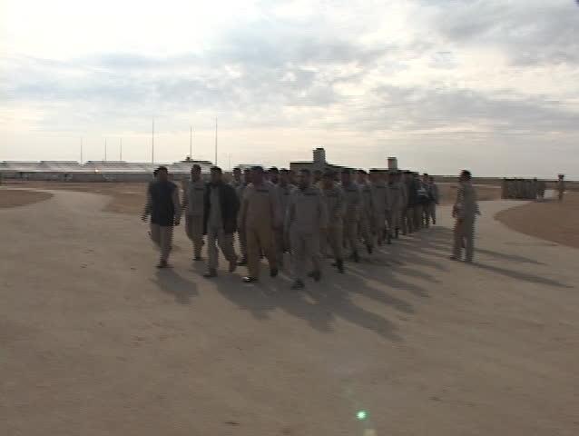 IRAQ - CIRCA 2003: Iraqi troops march along a road on the military base circa 2003 in Iraq.