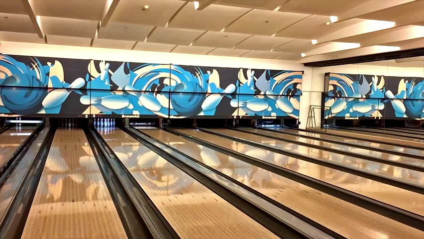 BUCHAREST, ROMANIA - JANUARY 27, 2016: Slow Motion Bowling Game Hitting Pins On Local Bowling Entertainment Club.