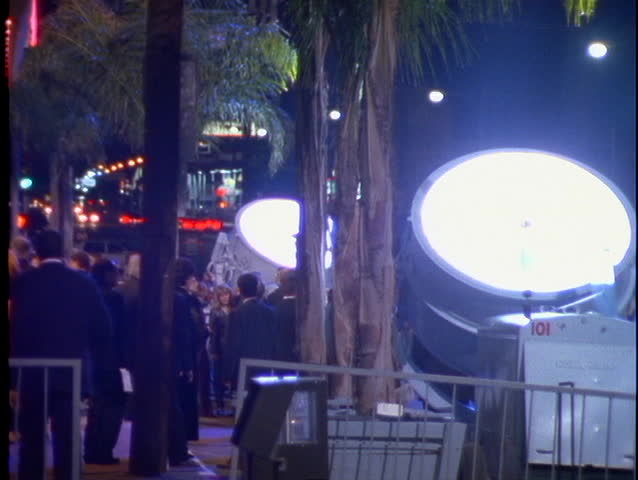 Searchlights light up the night sky in Hollywood, CA announcing a big movie premiere.