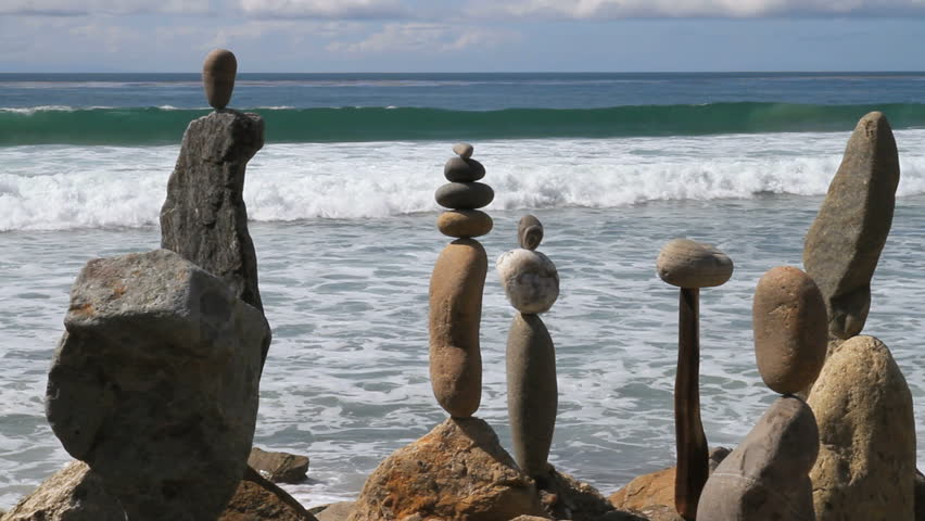Static shot of rocks balanced on top of each other. ocean waves in background. | Shutterstock HD Video #1421356