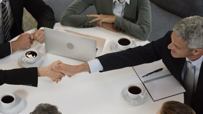 Business people having a handshake during a meeting - HD stock footage clip