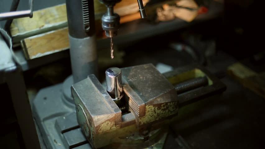 SAMARA, SAMARA REGION/RUSSIA - OCTOBER 15: Man drills gripped in a vise detail on a drilling machine on October 15, 2014 in Samara - HD stock video clip