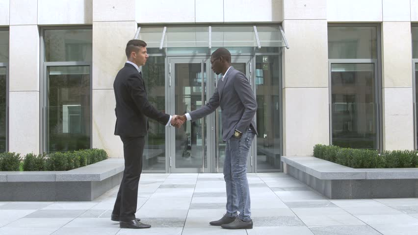 businessmen shaking hands, success multiracial Businesspeople - 4K stock footage clip