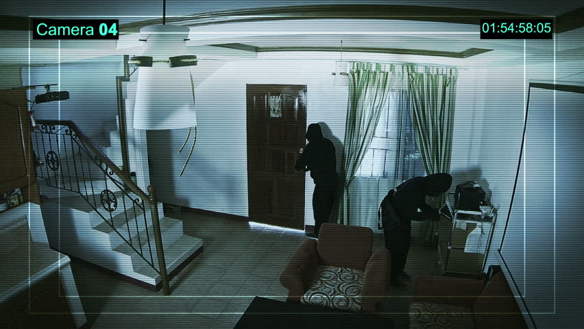CCTV Camera Operating inside apartment. The camera records real two robbers.