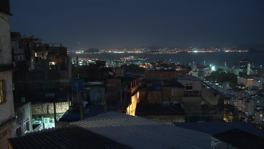 Oct 2008 - Rio De Janeiro, Brazil: static rooftop shot of cityscape and favela in Rio De Janeiro, Brazil with view of Guanabara Bay islands | Shutterstock HD Video #14326762