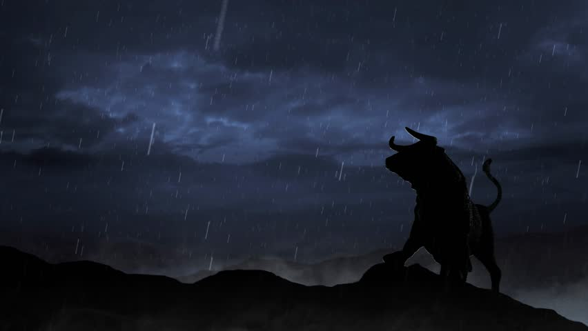 Stock Market Bull Silhouette in a Storm 4K Loop features the silhouette of a the stock market bull on a hill with storm clouds behind and rain falling and mist at its feet - 4K stock video clip