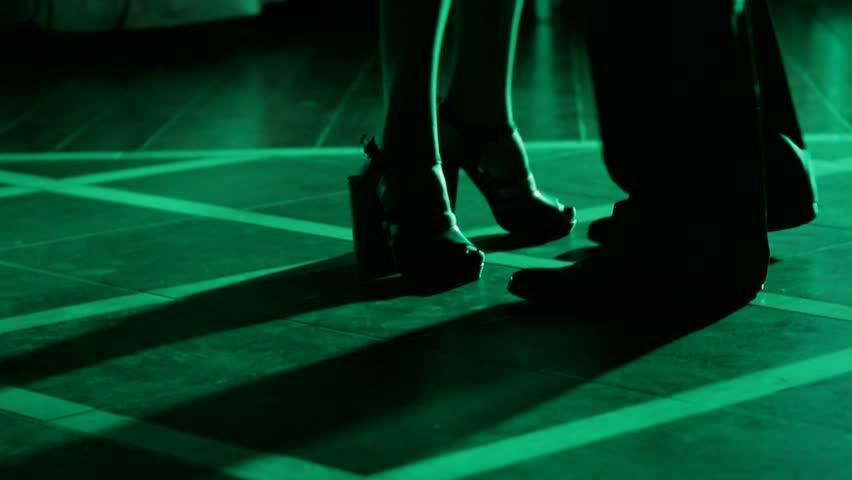 Lovers dancing on the dance floor. Dance of lovers. Dancing feet. Dancing in night clubs. - HD stock video clip