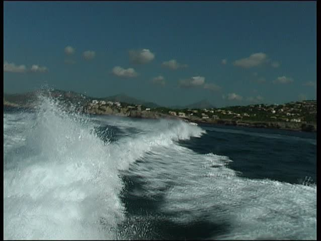 Fast daycruiser jumping backwash of motoryacht take 2 - SD stock footage clip