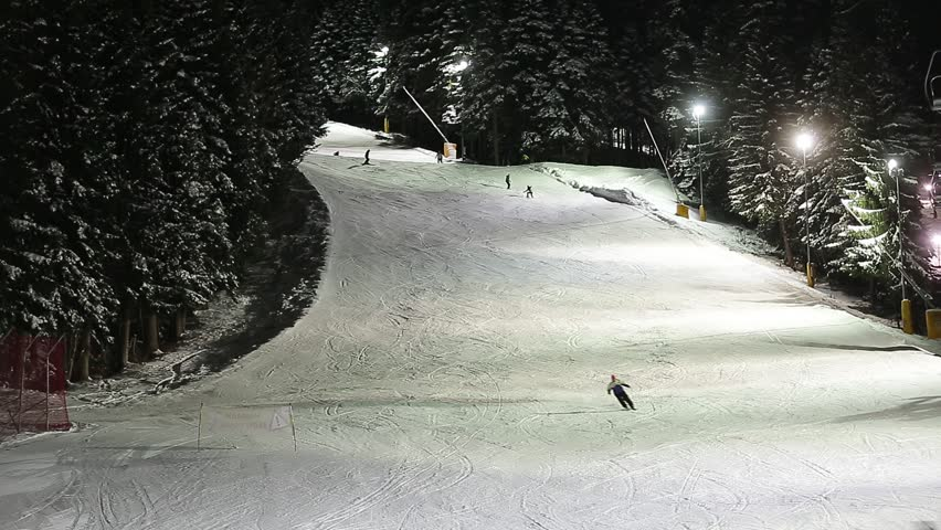 Night riding on the winter resort - HD stock video clip