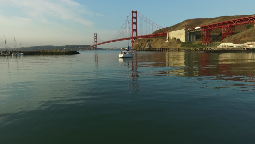 Sailboat and Golden Gate Bridge in San Fransisco, California, aerial shot