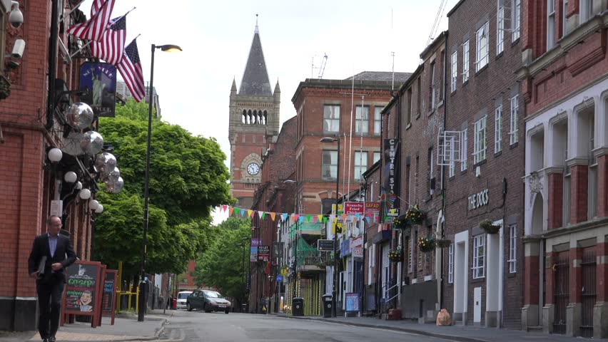 MANCHESTER - ENGLAND, MAY 28, 2015, 4K Beautiful street in residential district with church tower and local restaurant by day
