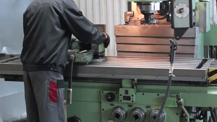 Worker on a machine metal lathe in factory. Machining process in the factory - HD stock footage clip