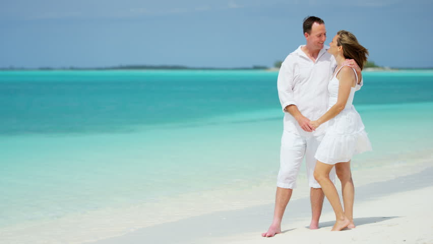 Loving carefree young male female Caucasian couple casual clothing Caribbean tourism travel promotion turquoise ocean beach RED DRAGON   Shutterstock HD Video #14556145