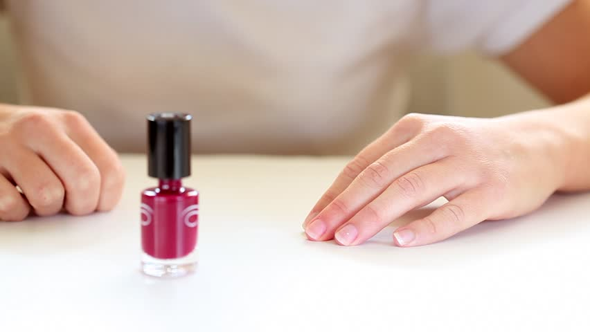 woman painting her nails red - HD stock footage clip