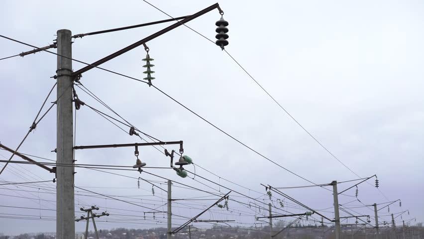 Closeup high-voltage networks in the field, Ukraine. 4K - 4K stock video clip