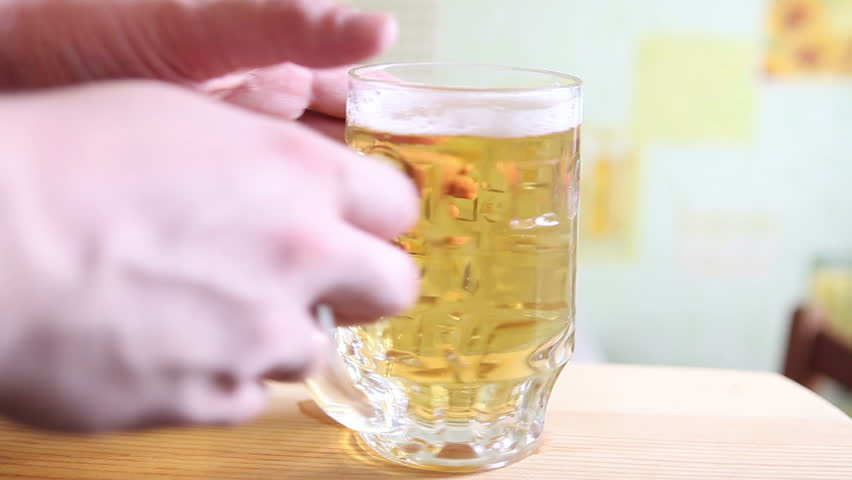 mug with beer taken from the table, close-up - HD stock footage clip