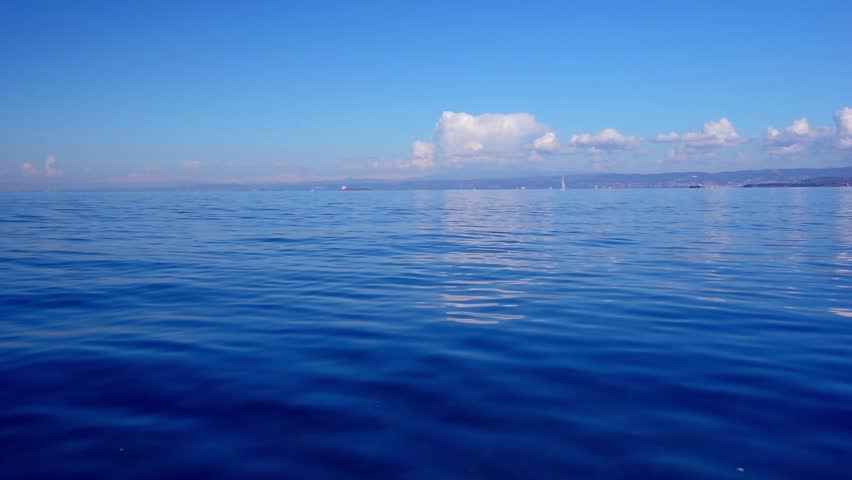 Seascape, sea view in sunny day, dark blue sea, blue sky, small clouds, calm sea surface, ripple soft waves, clouds reflection in the water. Full hd video sea background. | Shutterstock HD Video #14666881