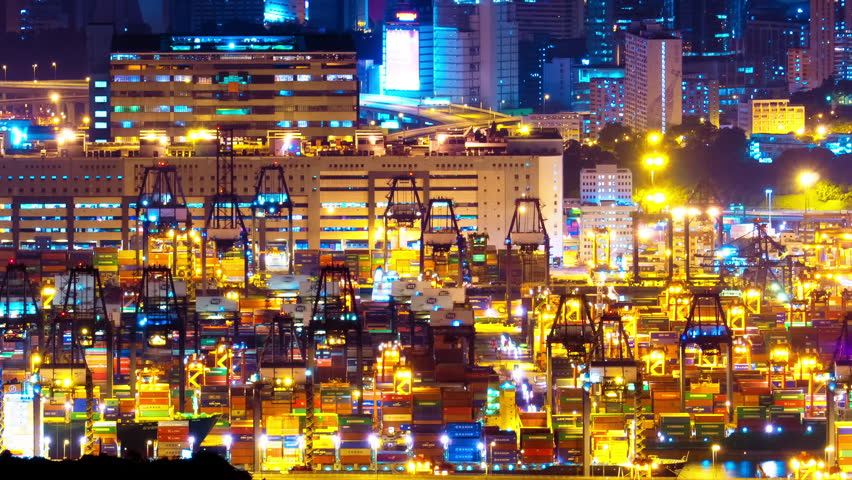 HONG KONG, CHINA - 17 JUL 2015: Night view on busy container terminal with cranes and cargo cars moving commercial goods in port of Hong Kong. Example of economic recovery of Asian region | Shutterstock HD Video #14682415