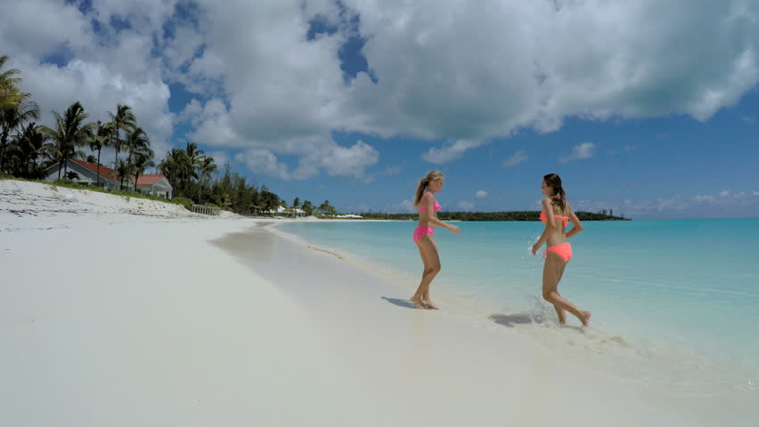 Young Caucasian female sisters in swimwear on luxury island beach | Shutterstock HD Video #14689750