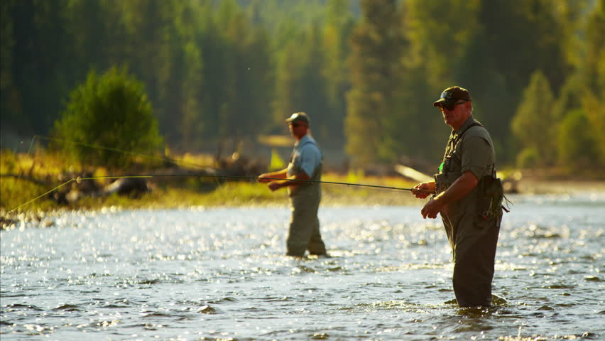Canadian males fly fishing in competition on freshwater for Fly fishing competitions