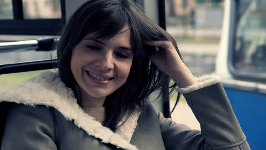Portrait of happy woman during tram ride