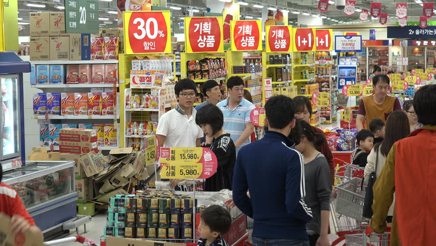 ANDONG, SOUTH KOREA - 3 OCTOBER 2015: Customers shop in a busy modern supermarket in Andong, grocery shopping in South Korea