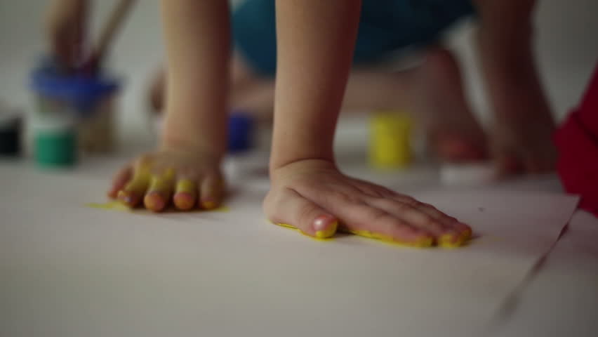 NOVOKUIBISHEVSK, SAMARA REGION/RUSSIA - FABUARY 15: Children draw on paper with brushes and gouache, they smear paint palms and press their palms to the paper on Fabuary 15, 2016 in Novokuibishevsk | Shutterstock HD Video #14785762