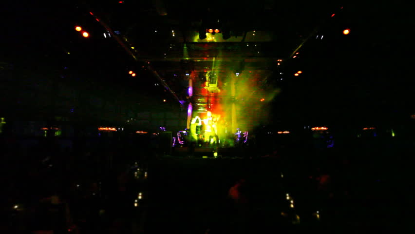 group of guys sing and dance on stage at night club in floodlights - HD stock footage clip