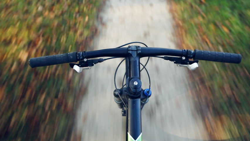Speed riding mountain bike on autumn dirt footpath in autumn woods. View from first person perspective POV. MTB, cycling, training and working out motivation and inspiration. | Shutterstock HD Video #14861281