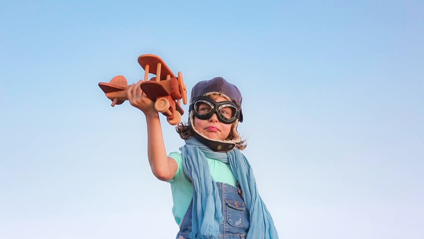 Happy child playing with toy airplane against summer sky background | Shutterstock HD Video #14863963