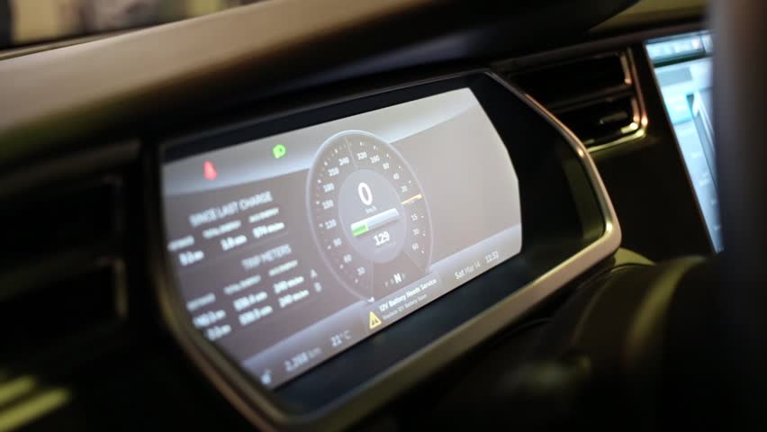 MOSCOW, RUSSIA - MAR 14, 2015: Main dashboard display of electric car Tesla Model S at the Third International Exhibition MATE 2015 in Exhibition Center Sokolniki. | Shutterstock HD Video #14868751