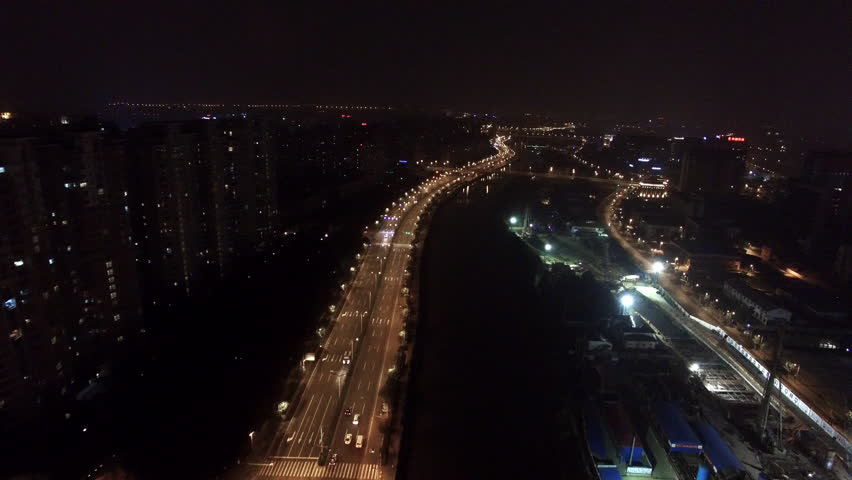 Aerial night shot of cars driving on a road along a river   Shutterstock HD Video #14879479