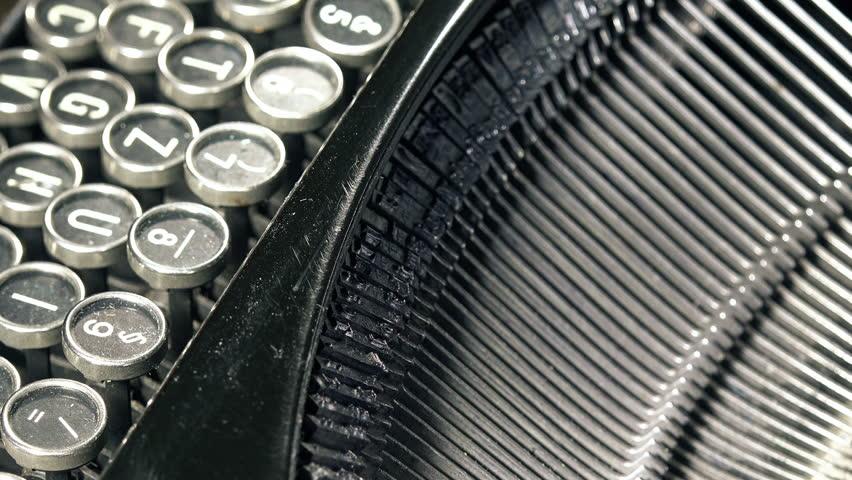 Old typewriter machine detail, typing text on vintage typing machine.