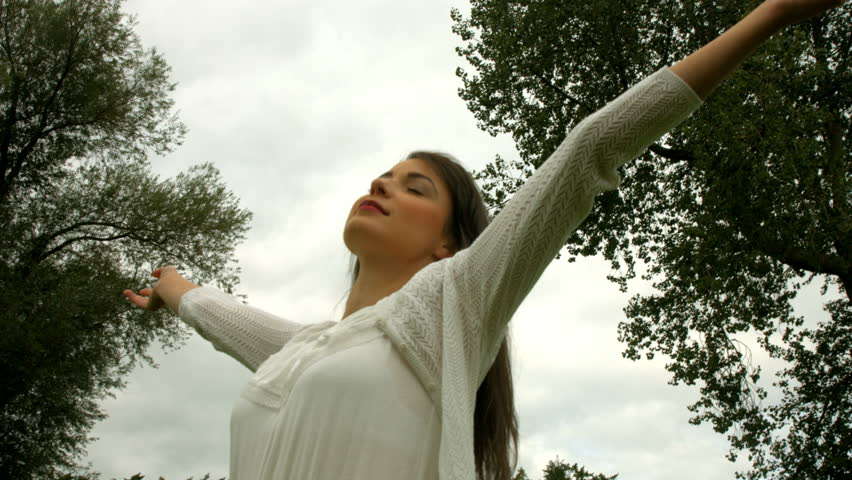 Pretty girl with arms outstretched outdoors | Shutterstock HD Video #14898136