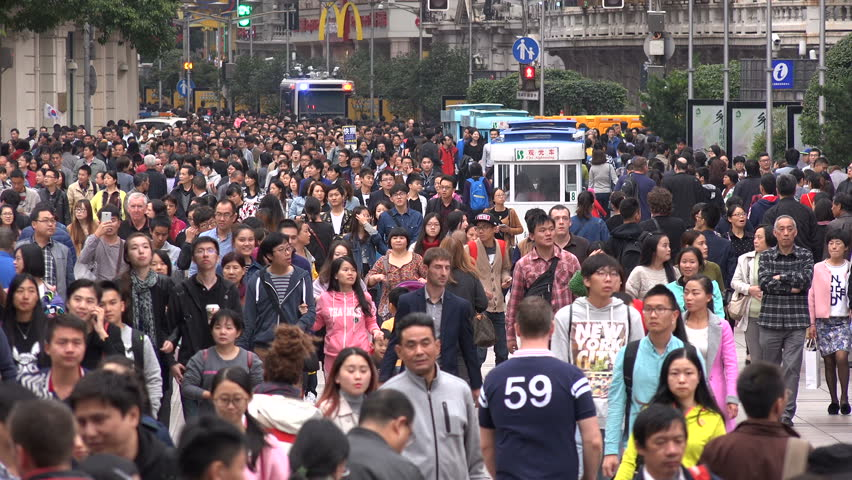 SHANGHAI, CHINA - 31 OCTOBER 2015: Busy crowded shopping street, people walk through the pedestrian only Nanjing Road in Shanghai, China - HD stock footage clip