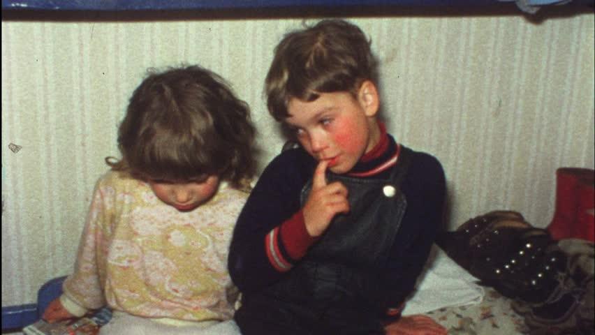 Sad boy wants sister to comfort him (Vintage 8 mm amateur film)