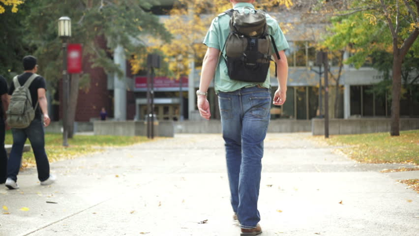 College student walking on a university campus.  | Shutterstock HD Video #1496569