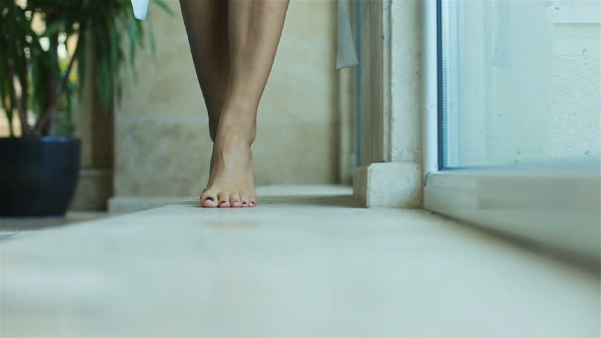 Bride walking on the windowsill barefoot close up - HD stock footage clip