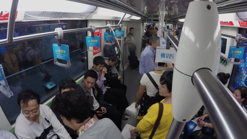 SHANGHAI - NOV 07, 2015: Many people ride in metro train by tunnel with commercial banners. Timelapse   Shutterstock HD Video #14990548