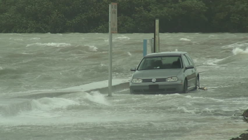 Hurricane storm surge engulfs a vehicle