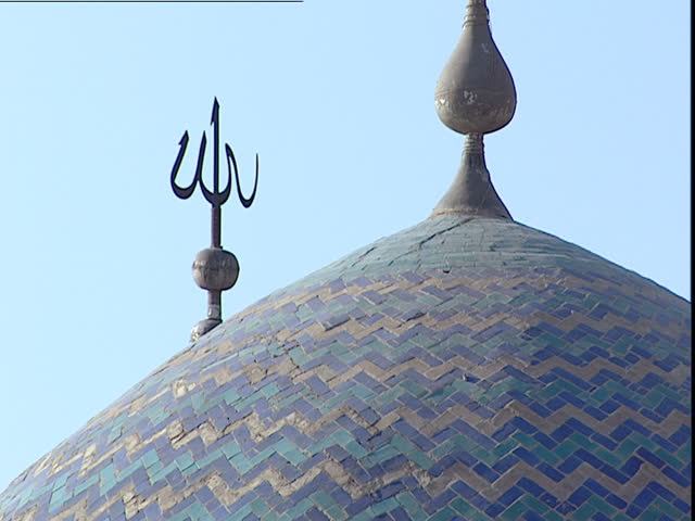 Baghdad, Iraq - 2002 - Close up of the cupola or dome of the Mustansiriya Madrasah mosque showing the blue tile work and a spike with the word God written in Arabic 'Allah'.