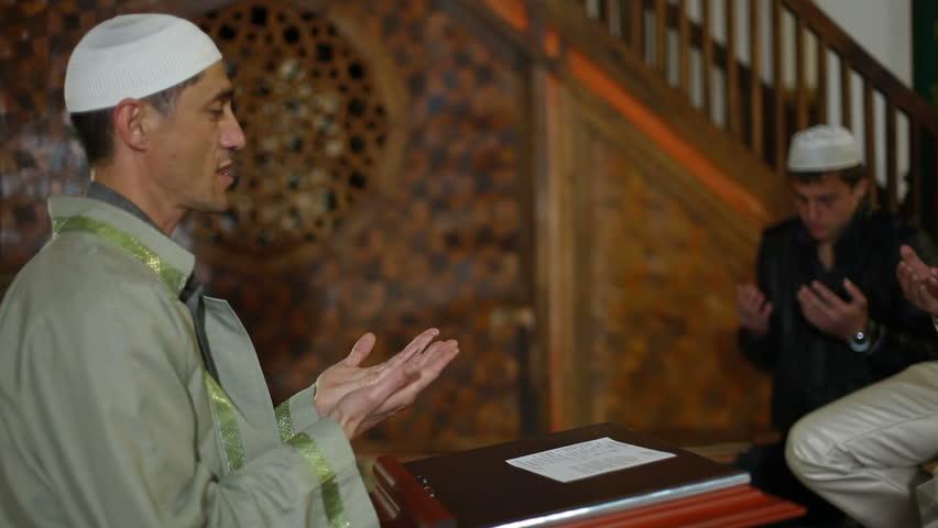 Mullah  praying during an Islamic wedding ceremony Nikah in  mosque Bakhchisaray Palace (Hansaray, Khan's Palace) Bakhchisaray, Crimea, Ukraine - HD stock footage clip