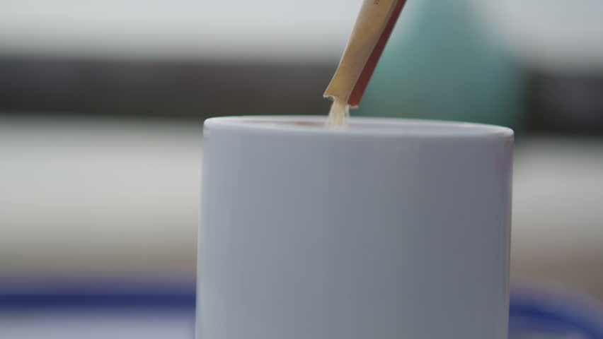 4K Close up on hands with a coffee mug at outdoor cafe. Shot on RED Epic. - 4K stock video clip