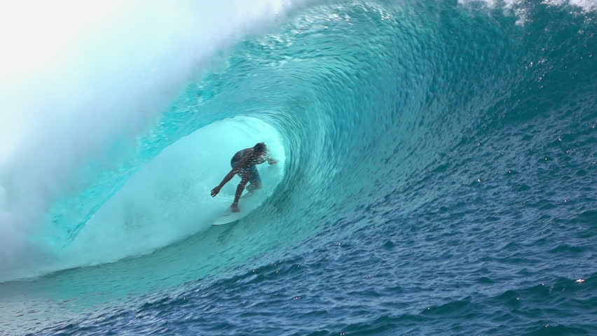 SLOW MOTION: Cheerful extreme pro surfer surfing big tube barrel wave Teahupoo in crystal clear Pacific ocean in sunny Tahiti island | Shutterstock HD Video #15148543