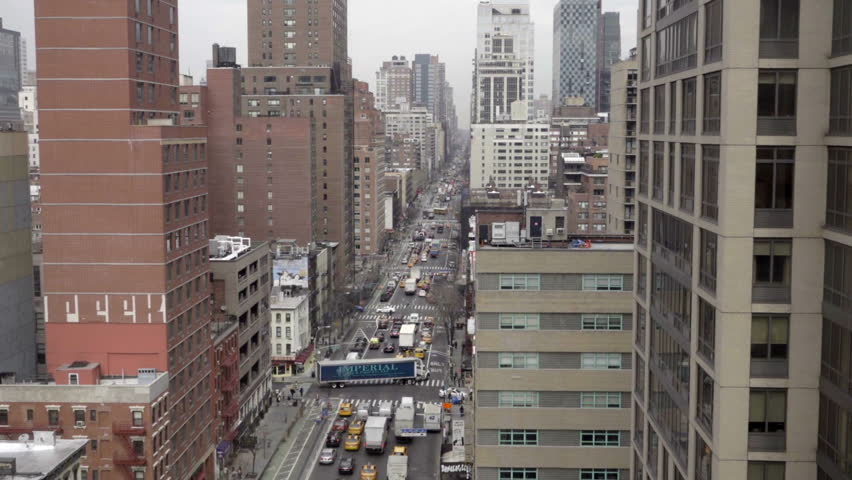 NEW YORK - MARCH 10, 2016: aerial view busy Manhattan street with truck causing holdup in NYC. Traffic is a major problem in the city, as the number of automobiles increases each year. | Shutterstock HD Video #15166129