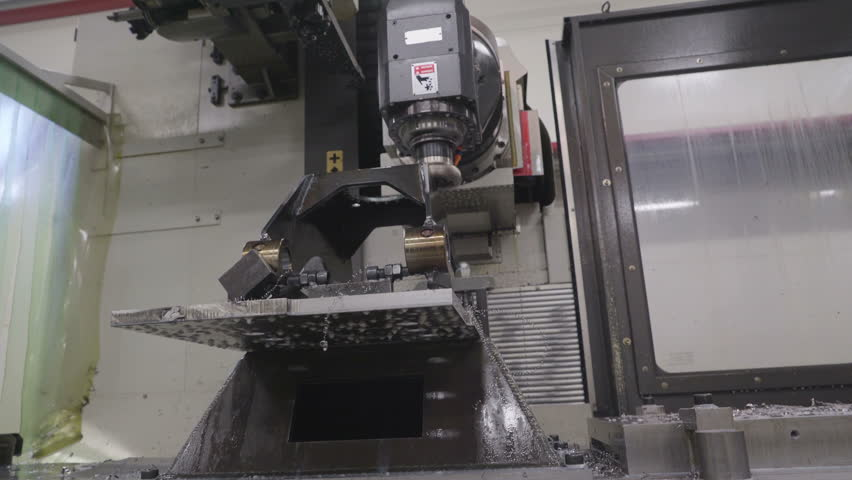 After the scraping process of the grapple. The metal scrapes are on the floor after the process - 4K stock video clip