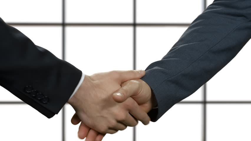 Politics shake hands. Don't believe what you see. Act natural. Concealed lies.   Shutterstock HD Video #15178828