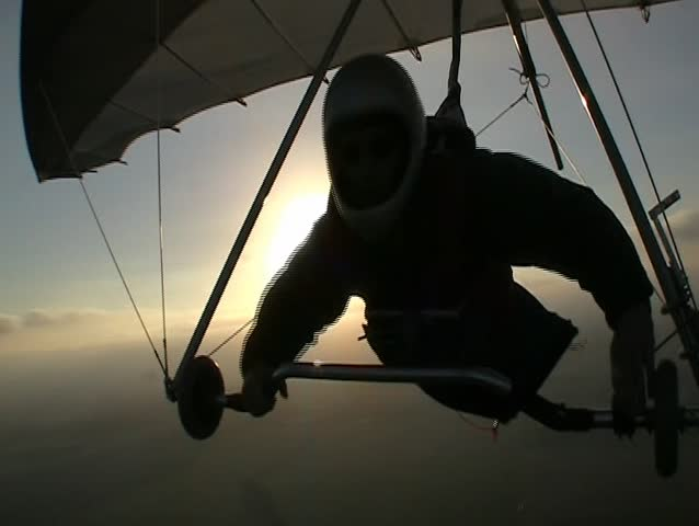 Hang glider pilot in silhoutte - SD stock video clip